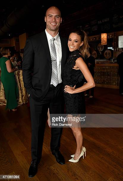 Professional football player Mike Caussin and singer/actress Jana Kramer attend the 16th Annual Nashville Best Cellars Dinner hosted by the TJ...