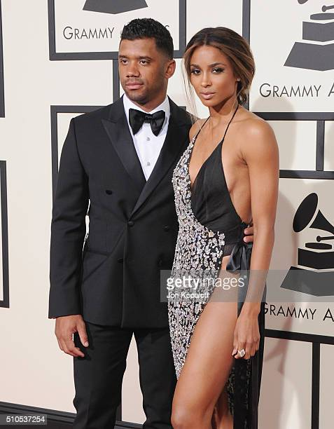 Professional football player Russell Wilson and singer Ciara arrive at The 58th GRAMMY Awards at Staples Center on February 15 2016 in Los Angeles...