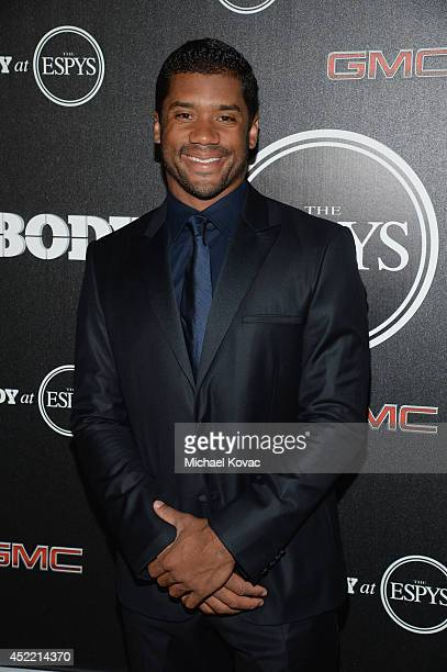 Professional football player Russell Wilson attends the Body at ESPYS PreParty at Lure on July 15 2014 in Hollywood California