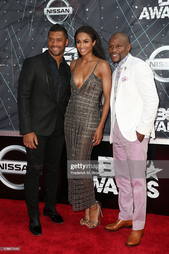Professional football player Russell Wilson, recording artist Ciara and professional boxer Floyd Mayweather Jr. attend the 2015 BET Awards at the Microsoft Theater on June 28, 2015 in Los Angeles, California.