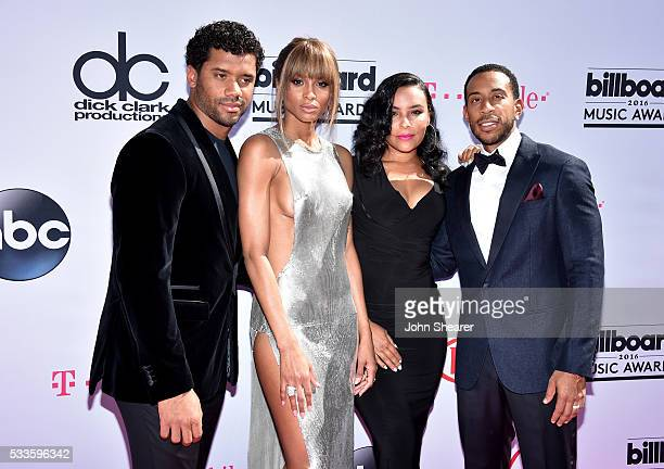 Professional football player Russell Wilson singer Ciara model Eudoxie Mbouguiengue and Ludacris attend the 2016 Billboard Music Awards at TMobile...