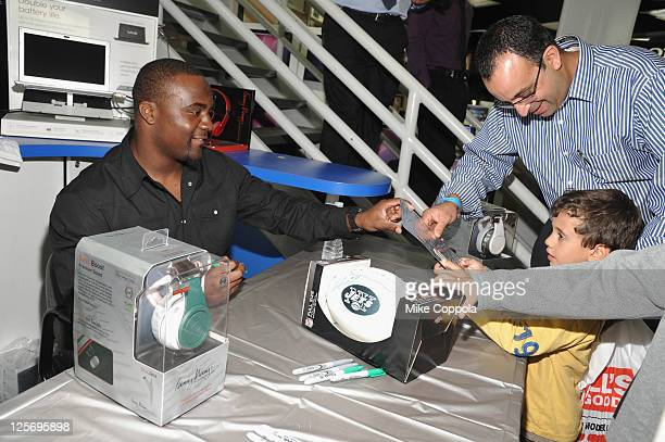 Professional football player Shonn Greene signs autographs for fans at Fanny Wang Headphone Co. Over Ear DJ Wangs Launch Party with Prince Amukamara,...