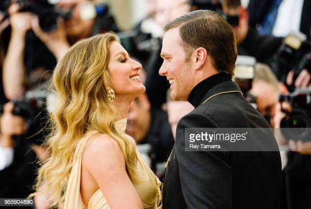 Professional football player Tom Brady and Gisele Bundchen enter the Heavenly Bodies Fashion The Catholic Imagination Costume Institute Gala at The...