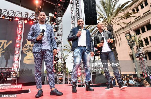 Professional football player Victor Cruz former professional football player Shawne Merriman and television personality Terrence J attend the 2017...
