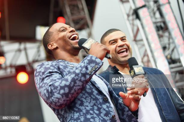 Professional football player Victor Cruz left and former professional football player Shawne Merriman attend the 2017 MTV Movie And TV Awards...