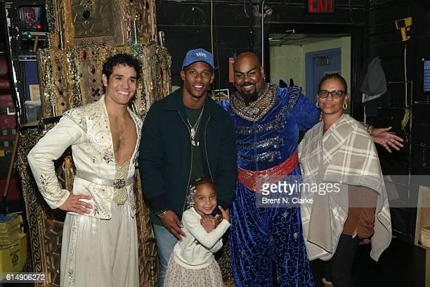 Professional football player Victor Cruz poses for photographs with Adam Jacobs daughter Kennedy Cruz James Monroe Iglehart and mother Bianca Cruz...