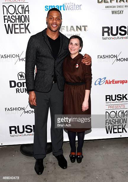 Professional football player Visanthe Shiancoe and fashion designer Katty Xiomara attend the Katty Xiomara show during Nolcha Fashion Week New York...