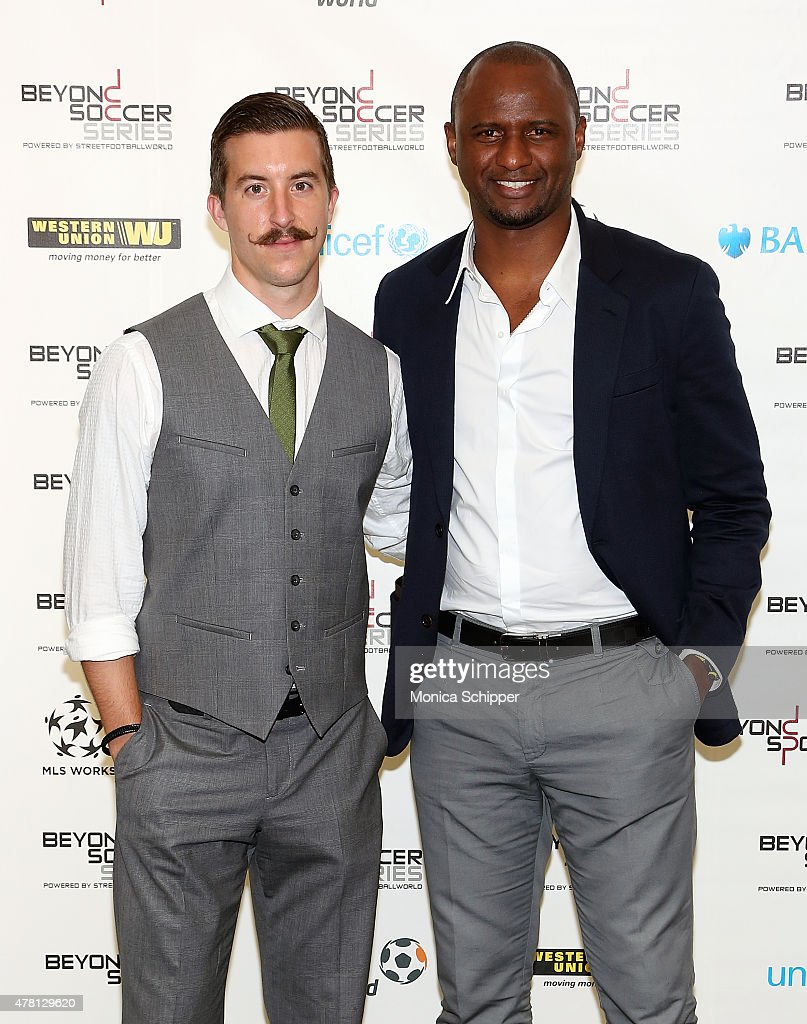 Professional football player with New York City FC Jeb Brovsky (L) and former professional football player and Western Union Pass Ambassador Patrick Vieira attend the Beyond Soccer Series Powered By streetfootballworld at Thomson Reuters Building on June 22, 2015 in New York City.