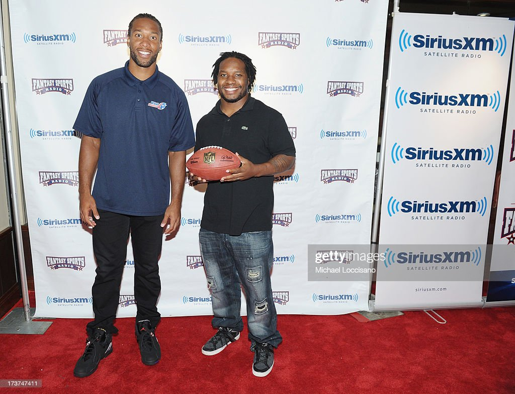 Professional Football players Larry Fitzgerald (L) and Maurice Jones-Drew attend the SiriusXM Celebrity Fantasy Football Draft at Hard Rock Cafe - Times Square on July 17, 2013 in New York City.