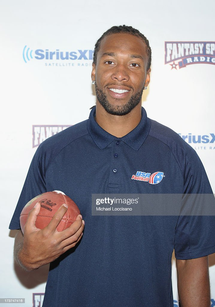 Professional Football players Larry Fitzgerald attends the SiriusXM Celebrity Fantasy Football Draft at Hard Rock Cafe - Times Square on July 17, 2013 in New York City.