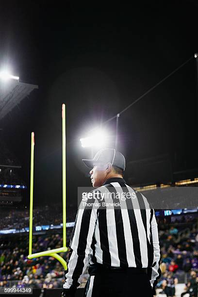 Professional football referee standing at end zone