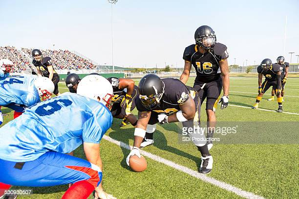 professional football teams preparing for play during game at stadium - quarterback stock pictures, royalty-free photos & images