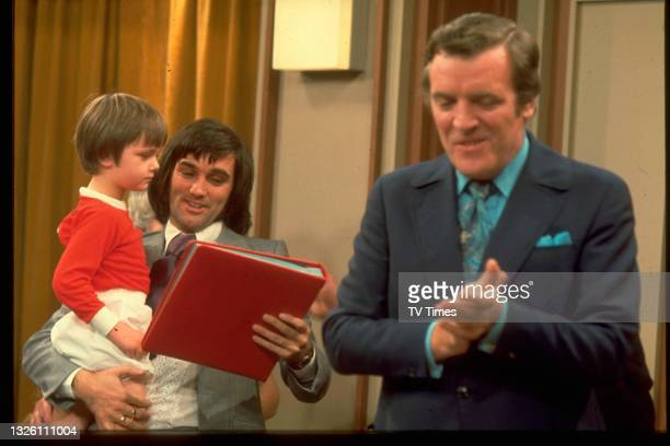 Professional footballer George Best holding his younger brother Ian during a recording of This Is Your Life with host Eamonn Andrews in the...