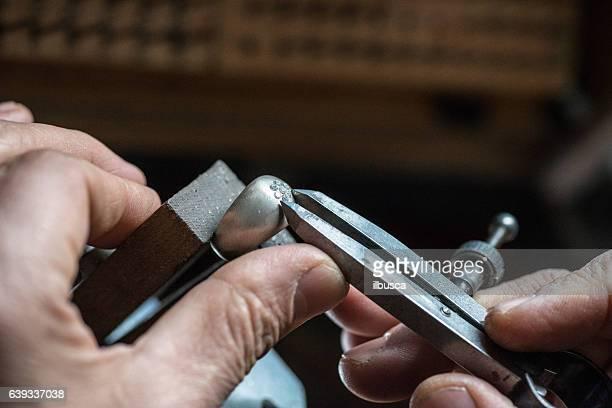 Professional gemstone settings jewellery craft laboratory: Checking diamond on ring