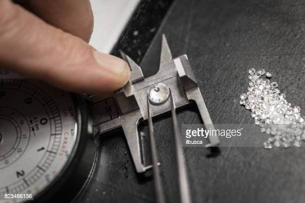 Professional gemstone settings jewellery craft laboratory: Choosing diamonds