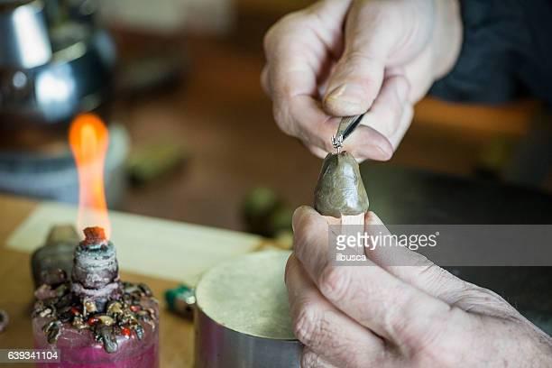 Professional gemstone settings jewellery craft laboratory: Man molding a shape