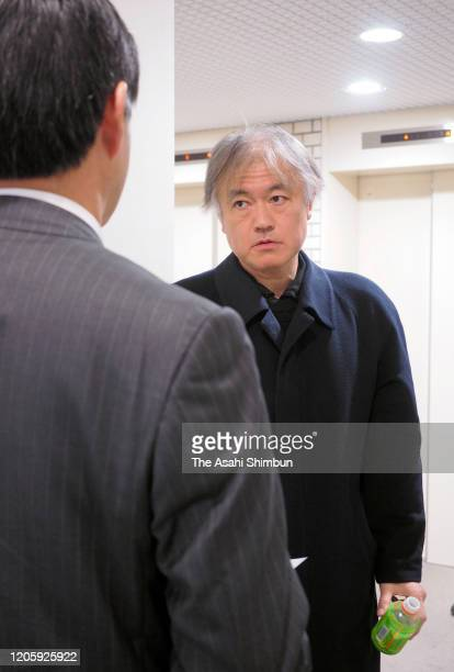 Professional Go player Norimoto Yoda squares off with Nihon KiIn Managing Director Norito Obuchi as he appears to compete a match which had been a...