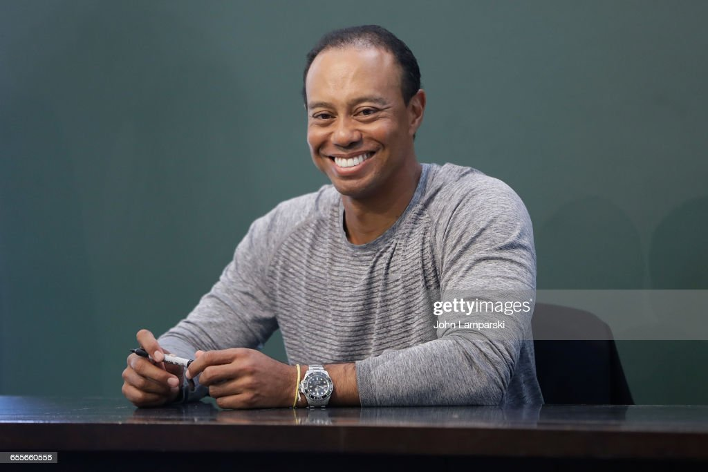 """Tiger Woods Signs Copies Of His New Book """"The 1997 Masters: My Story"""" : News Photo"""