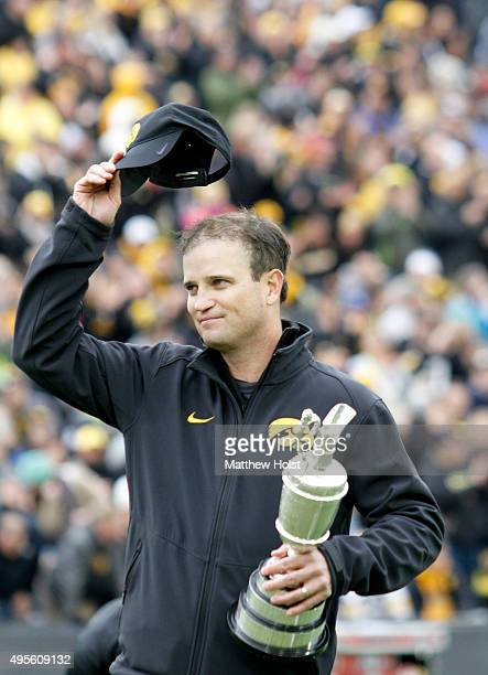 Professional golfer and winner of the British Open Zach Johnson holds the Claret Cup as he is introduced before the Big Ten matchup between the Iowa...