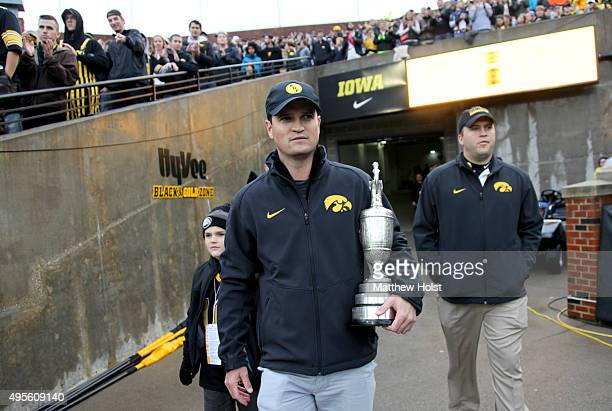 Professional golfer and winner of the British Open Zach Johnson carries the Claret Cup before the Big Ten matchup between the Iowa Hawkeyes and the...