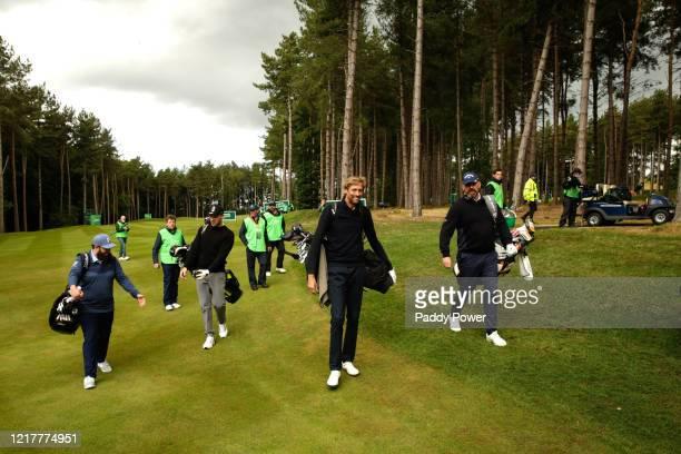 Professional golfer Andrew Johnston, former cricketer Freddie Flintoff, former footballer Peter Crouch and professional golfer Thomas Bjorn carry...