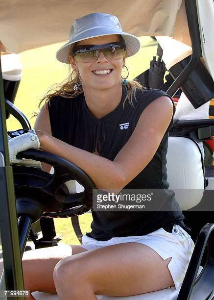 Professional golfer Anna Rawson steers the golf cart at the 9th annual American Film Institute Golf Classic at he Trump National Golf Club September...