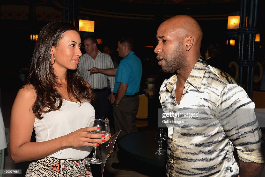Professional golfer Cheyenne Woods (L) chats with British DJ Spoony (Jonathan Joseph) during the official welcome function ahead of the Gary Player Invitational presented by Coca-Cola at The Palace Hotel and The Lost City Golf Course on November 14, 2013 in Sun City, South Africa.