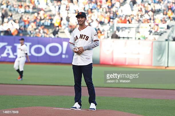 Professional golfer Dustin Johnson stands on the pitchers mound to throw the ceremonial first pitch before the game between the San Francisco Giants...