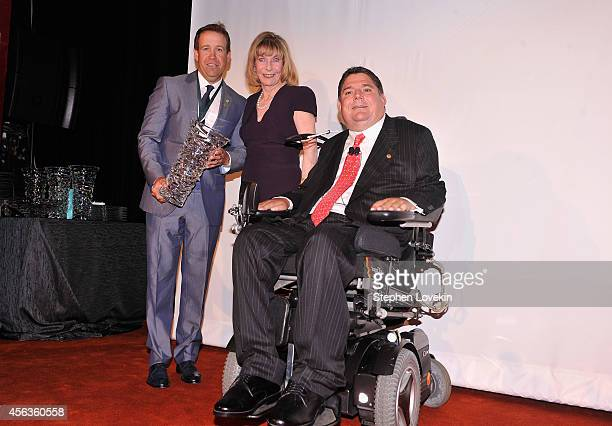 Professional golfer Erik Compton Terry Buoniconti and President of the Buoniconti Fund Marc Buoniconti attends the 29th Annual Great Sports Legends...