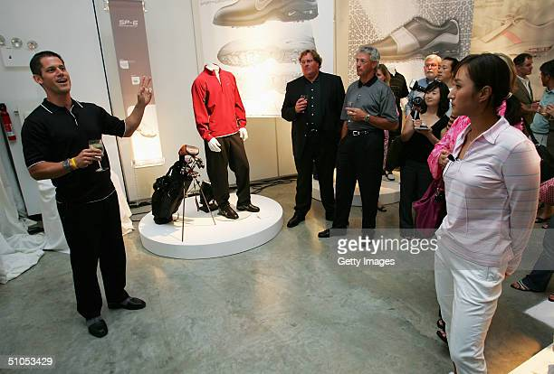 Professional golfer Grace Park listens to a Nike representive at the Nike July FORE event their annual golf clothing event on July 12 2004 at the...