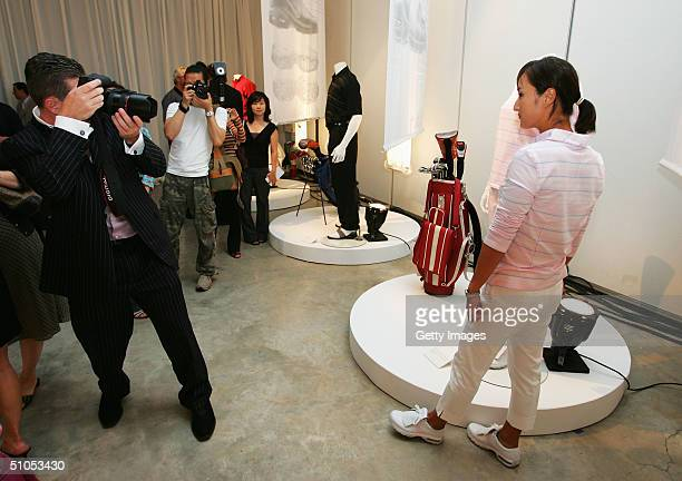 Professional golfer Grace Park poses for photographers at the Nike July FORE event their annual golf clothing event on July 12 2004 at the...