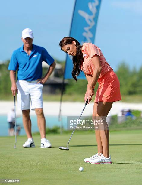 Professional Golfer Greg Norman and Golf Channel Holly Sonders attends the Golf Clinic with Greg Norman and Golf Tournament during Day Three of the...