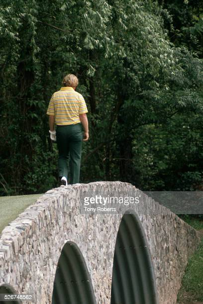 Professional golfer Jack Nicklaus crosses Hogan Bridge near the 12th hole of the Augusta National Course during the Masters Tournament