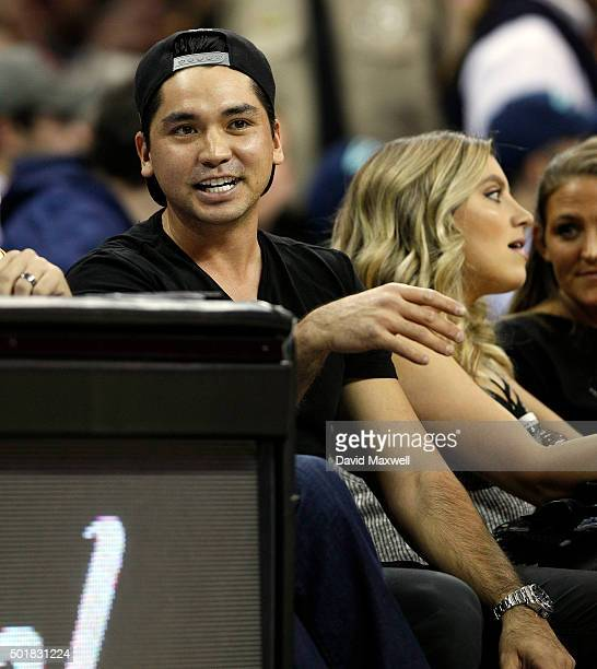 Professional Golfer Jason Day sits with his wife Ellie Day during the second half of the NBA game between the Cleveland Cavaliers and the Oklahoma...