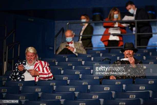 US professional golfer John Daly and musician Kid Rock are seen after being rold to wear a face mask ahead of the final presidential debate at...