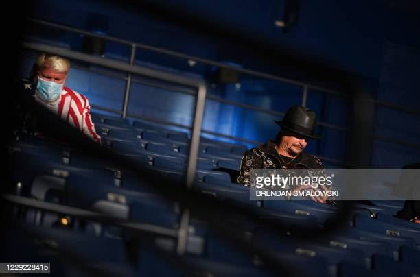US professional golfer John Daly and musician Kid Rock are seen ahead of the final presidential debate at Belmont University in Nashville Tennessee...