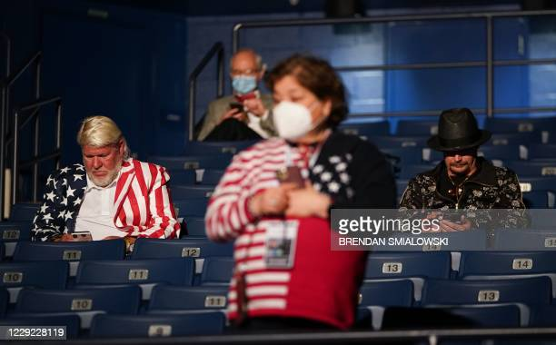 TOPSHOT US professional golfer John Daly and musician Kid Rock are seen seating ahead of the final presidential debate at Belmont University in...
