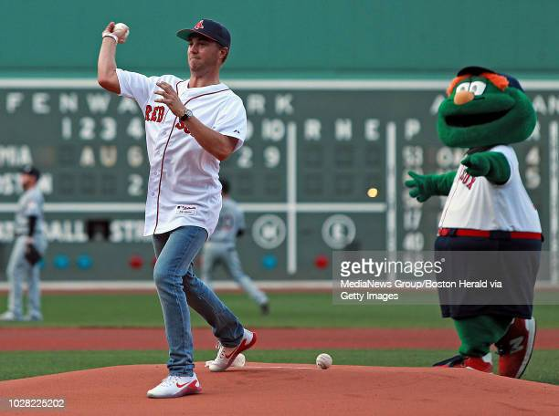 Professional golfer Justin Thomas throws out the first pitch before the the MLB game against the Miami Marlins at Fenway Park on August 29, 2018 in...