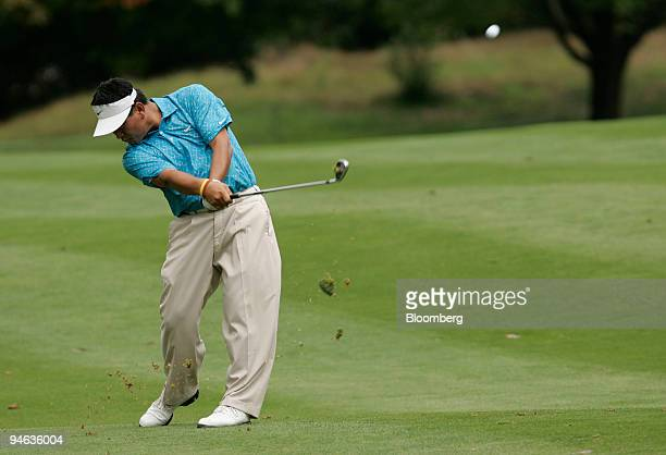 Professional golfer KJ Choi hits down the fairway of the 4th hole during the Barclays Classic tournament at Westchester Country Club in Rye New York...