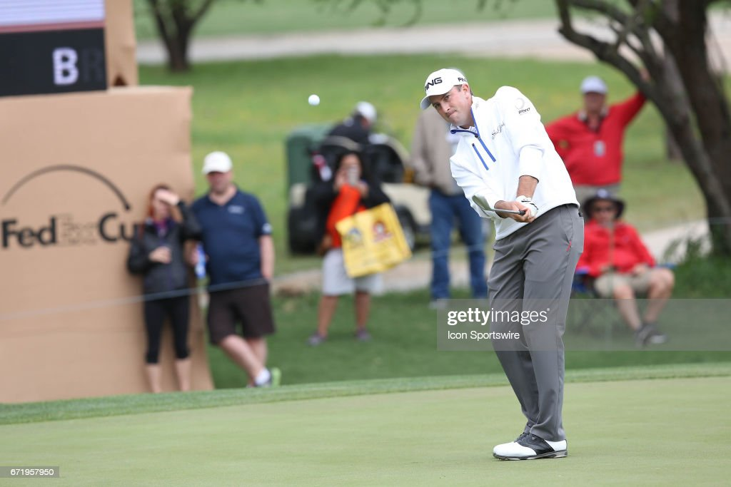Professional golfer Michael Thompson chips the ball from the putting surface of the 16th hole during the 3rd round of The Valero Texas Open on April 22, 2017 at TPC San Antonio in San Antonio, TX.