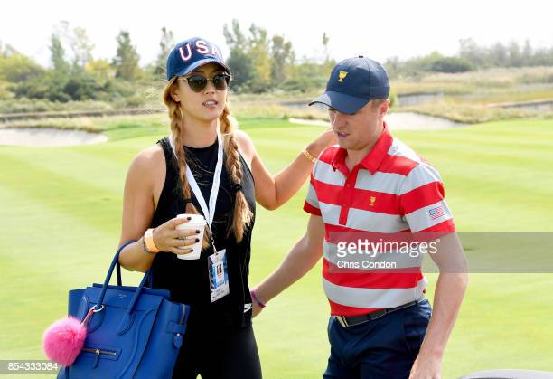 Professional golfer Michelle Wie talks with Justin Thomas of the US Team prior to the start of the Presidents Cup at Liberty National Golf Club on...