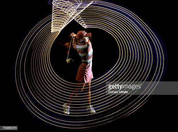 Professional Golfer Natalie Gulbis shows the path of her golf swing in a long exposure shot during a Calendar Shoot at the Lake Las Vegas Resort on...