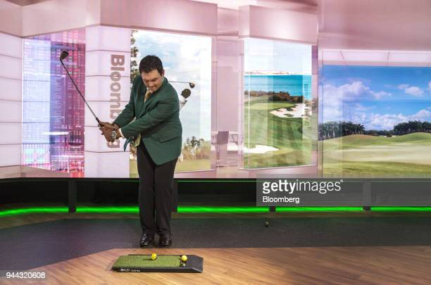 Professional golfer Patrick Reed swings a gold club during a Bloomberg Television interview in New York US on Tuesday April 10 2018 Reed talked about...