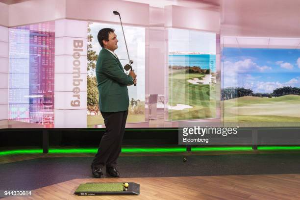 Professional golfer Patrick Reed swings a golf club during a Bloomberg Television interview in New York US on Tuesday April 10 2018 Reed talked about...