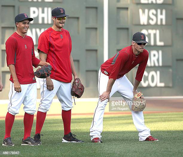 Professional golfer Rickie Fowler takes fielding practice with Clay Buchholz and Joe Kelly of the Boston Red Sox before a game against the New York...