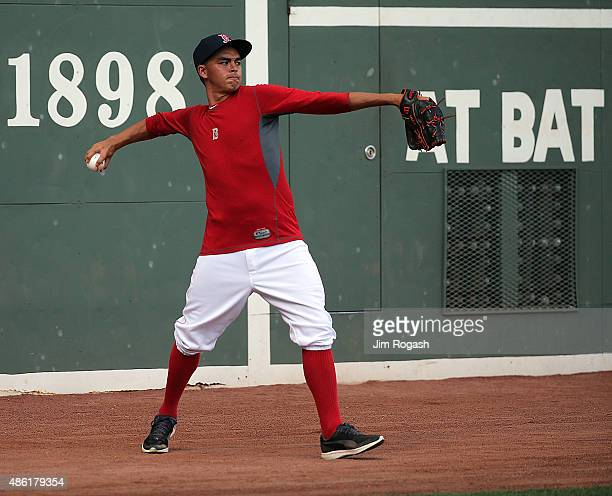 Professional golfer Rickie Fowler takes fielding practice with the Boston Red Sox before a game against the New York Yankees at Fenway Park on...