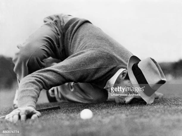 Professional golfer Sam Snead lines up a putt during the Masters Tournament but lost in the final round to Ralph Guldahl Augusta Georgia 1939