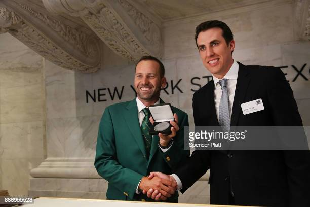Professional golfer Sergio Garcia holds a commemorative award presented by John Tuttle Global Head of Listings at New York Stock Exchange on the...