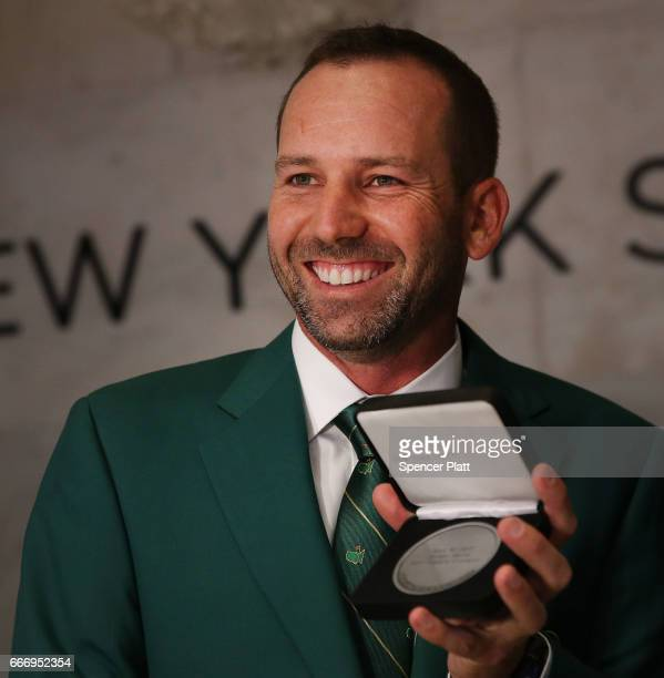 Professional golfer Sergio Garcia holds a commemorative award on the Floor of the New York Stock Exchange a day after winning the 81st Masters...