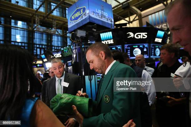 Professional golfer Sergio Garcia tours the floor of the New York Stock Exchange a day after winning the 81st Masters tournament on April 10 2017 in...